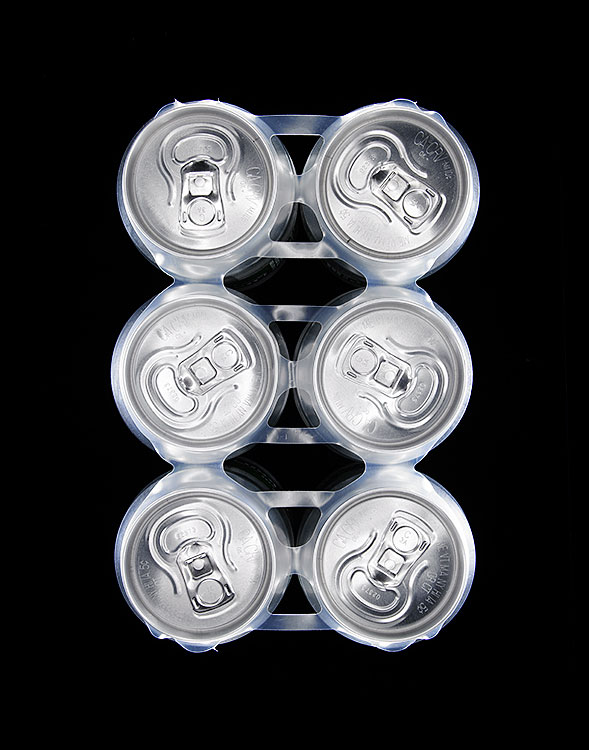 PICTURE HEINEKEN CANS ON A BLACK BACKGROUND PHOTOGRAPHED BY THEBEHRENS.NYC