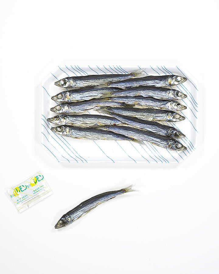 PHOTOGRAPH OF DRIED FISH ON WHITE BACKGROUND